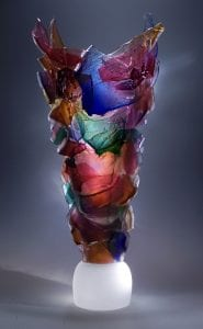 Caleb Nichols works on display for the exhibit Of Metal and Glass at Syd Entel Galleries
